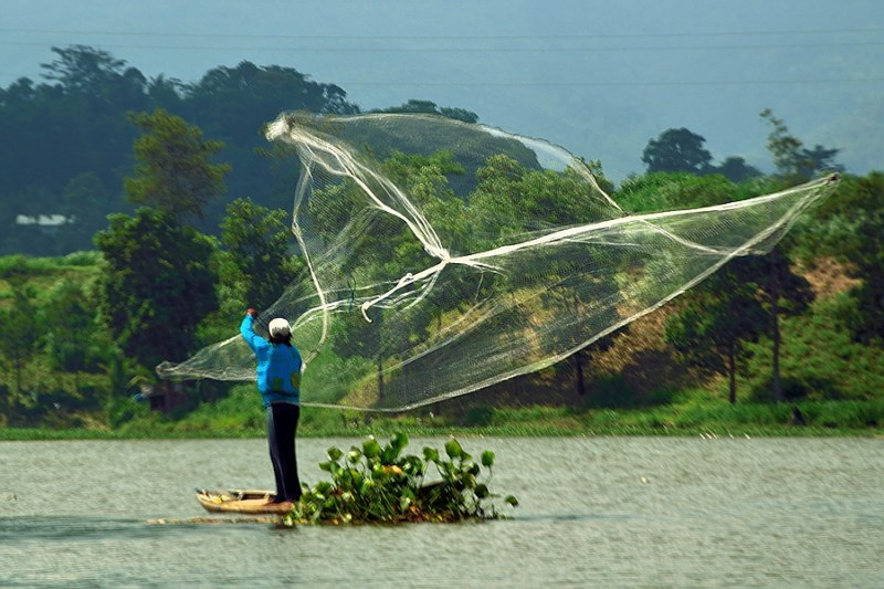 A fisherman fishing with his special technique